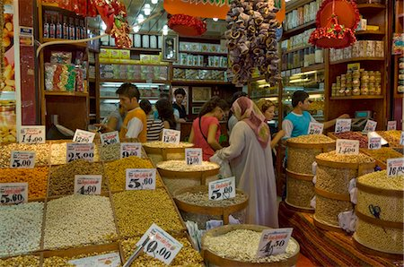 food stalls - People buying pulses, nuts and spices at a stall in the Egyptian bazaar (Spice bazaar) (Misir Carsisi), Eminonu, Istanbul, Turkey, Europe Stock Photo - Rights-Managed, Code: 841-03868231