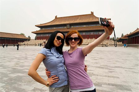 Tourists taking their own photograph in front of the Hall for Worship Of Ancestors, The Forbidden City, Beijing, China, Asia Stock Photo - Rights-Managed, Code: 841-03871471