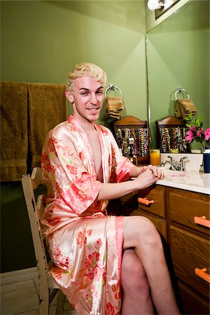 Drag queen in robe sitting in bathroom Stock Photo - Rights-Managed, Code: 842-05979284