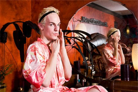 Drag queen sitting at vanity getting ready Stock Photo - Rights-Managed, Code: 842-05979286