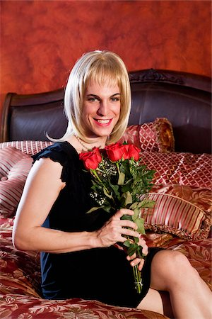 Drag queen holding red roses Stock Photo - Rights-Managed, Code: 842-05979288