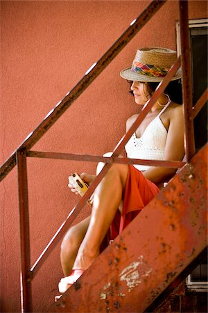 sexy women legs - Young woman in hat holding tambourine sitting on red staircase Stock Photo - Rights-Managed, Code: 842-05979444