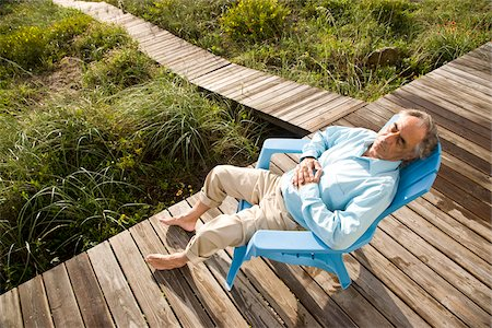Senior man sitting on chair snoozing in the sun Stock Photo - Rights-Managed, Code: 842-05979507