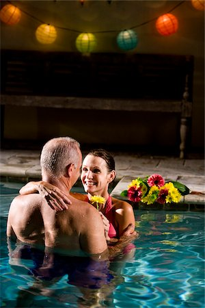 seniors woman in swimsuit - Mature romantic couple embracing in pool at night Stock Photo - Rights-Managed, Code: 842-05979612