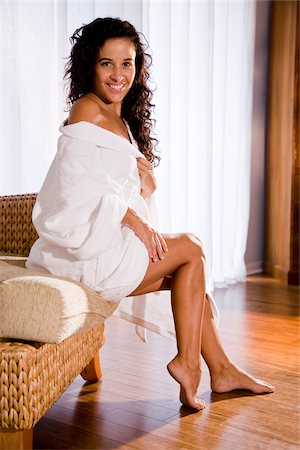 sexy women legs - Beautiful Hispanic woman sitting on sofa wearing white bathrobe Stock Photo - Rights-Managed, Code: 842-05979725