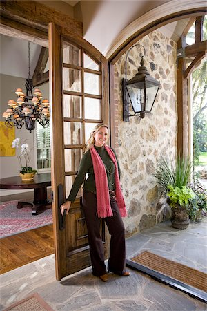 Mid-adult woman standing at doorway of elegant home Stock Photo - Rights-Managed, Code: 842-05979744