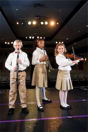 Young students playing musical instruments in school auditorium Stock Photo - Rights-Managed, Code: 842-05979896