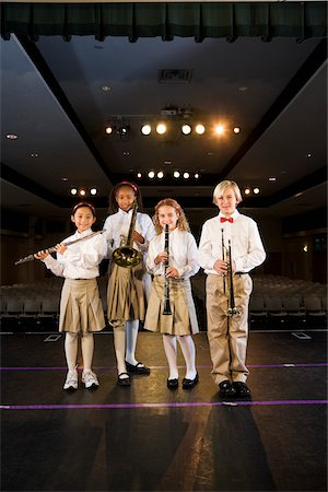 Young students playing musical instruments in school auditorium Stock Photo - Rights-Managed, Code: 842-05979897