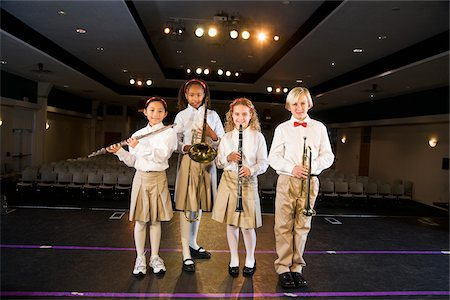 Young students playing musical instruments in school auditorium Stock Photo - Rights-Managed, Code: 842-05979898