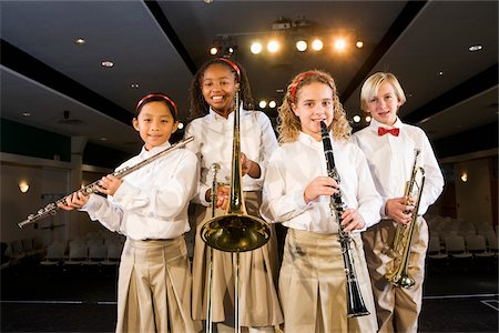 Young students playing musical instruments in school auditorium Stock Photo - Rights-Managed, Code: 842-05979899