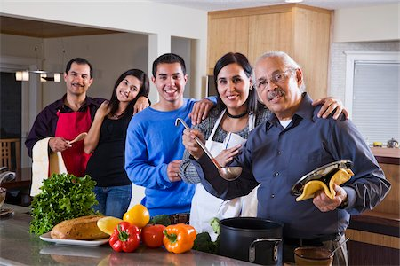 Three generations, Hispanic family cooking together in kitchen at home Stock Photo - Rights-Managed, Code: 842-05979915