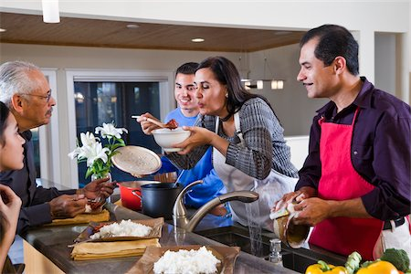 Hispanic mother serving home-cooked meal to family in kitchen Stock Photo - Rights-Managed, Code: 842-05979918