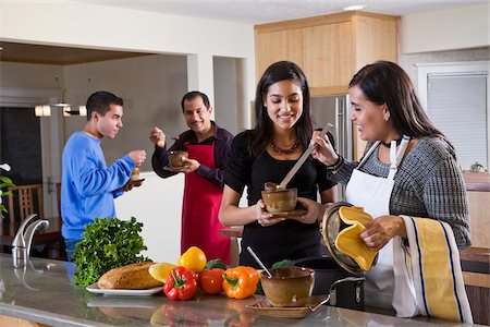 Hispanic family at home in kitchen eating food Stock Photo - Rights-Managed, Code: 842-05979912