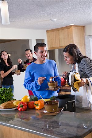Hispanic family at home in kitchen eating food Stock Photo - Rights-Managed, Code: 842-05979913