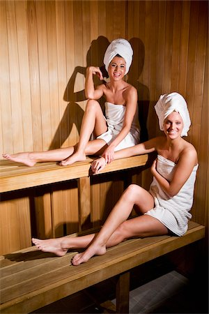 Young women relaxing in sauna wrapped in towels Stock Photo - Rights-Managed, Code: 842-05980068