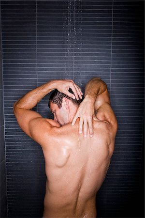 Back of man taking a shower Stock Photo - Rights-Managed, Code: 842-05980088