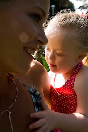 Close up of mother and daughter with downs syndrome Stock Photo - Rights-Managed, Code: 842-02654180