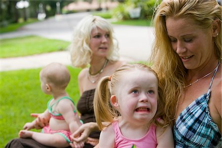 Mothers with baby and daughter with downs syndrome crying Stock Photo - Rights-Managed, Code: 842-02654183