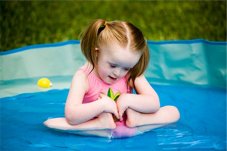 Girl with downs syndrome playing in kiddie pool Stock Photo - Rights-Managed, Code: 842-02654202