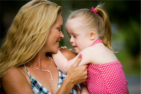 Close up profilt of mother and daughter with downs syndrome Stock Photo - Rights-Managed, Code: 842-02654210