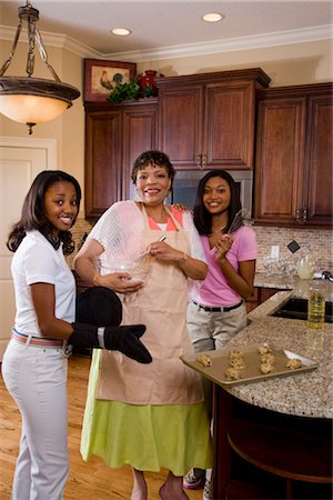 Portrait of mother/grandmother and teenage daughters baking cookies in kitchen Stock Photo - Rights-Managed, Code: 842-02654354