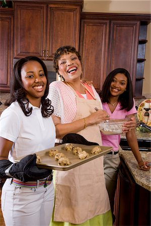 Portrait of mother/grandmother and teenage daughters baking cookies in kitchen Stock Photo - Rights-Managed, Code: 842-02654356