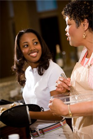 Side view of mother/grandmother and teenage daughter baking cookies Stock Photo - Rights-Managed, Code: 842-02654425