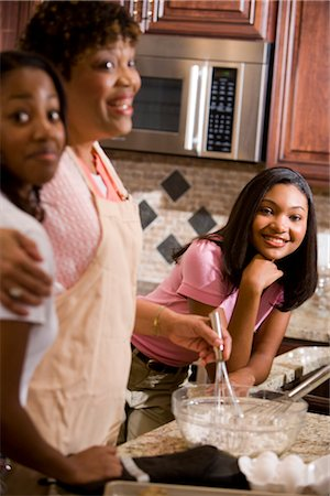 Portrait of parents/grandparents and teenage daughters cooking Stock Photo - Rights-Managed, Code: 842-02654427