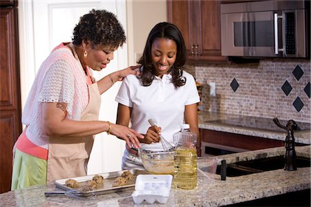 Portrait of mother/grandmother and teenage daughter baking cookies Stock Photo - Rights-Managed, Code: 842-02654430