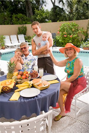 seniors woman in swimsuit - Portrait of extended family relaxing by swimming pool with fruit on table Stock Photo - Rights-Managed, Code: 842-02654912