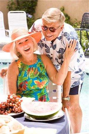 seniors woman in swimsuit - Mature couple on tropical vacation by pool Stock Photo - Rights-Managed, Code: 842-02654994