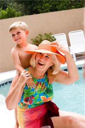 seniors woman in swimsuit - Grandson embracing grandmother by swimming pool Stock Photo - Rights-Managed, Code: 842-02654996