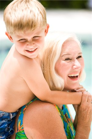 seniors woman in swimsuit - Grandson hugging grandmother by swimming pool Stock Photo - Rights-Managed, Code: 842-02655024