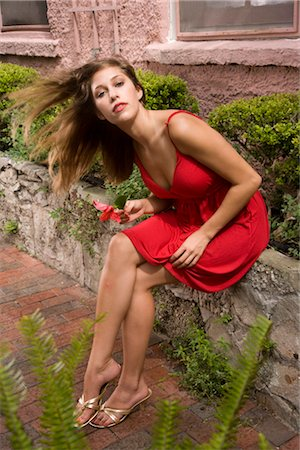 sexy women legs - Portrait of attractive young woman sitting on wall outside building Stock Photo - Rights-Managed, Code: 842-02655360