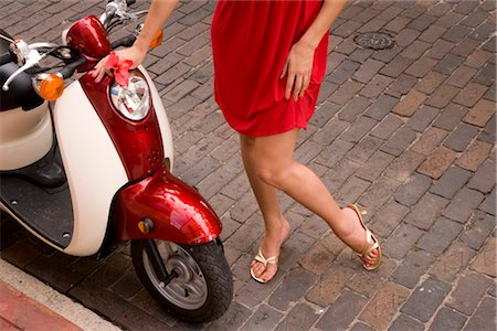 sexy women legs - Legs of woman standing on cobblestone road next to motor scooter Stock Photo - Rights-Managed, Code: 842-02655361