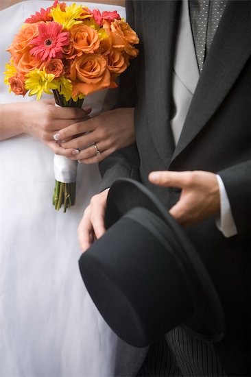 Midsection close-up shot of bride and groom holding bouquet and top hat Stock Photo - Premium Rights-Managed, Artist: Kablonk! RM, Image code: 842-02650003