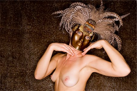 Portrait of young nude woman wearing masquerade mask, studio shot Stock Photo - Rights-Managed, Code: 842-02650244