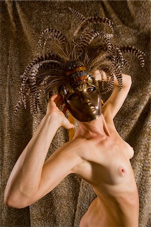 Portrait of young nude woman wearing masquerade mask, studio shot Stock Photo - Rights-Managed, Code: 842-02650240