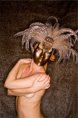 Portrait of young nude woman wearing masquerade mask, studio shot Stock Photo - Rights-Managed, Code: 842-02650242