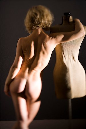 erotic female figures - Rear view of young nude woman standing with dressmakers model, studio shot Stock Photo - Rights-Managed, Code: 842-02650259