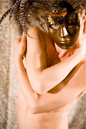 Portrait of young woman wearing masquerade mask, studio shot Stock Photo - Rights-Managed, Code: 842-02650270