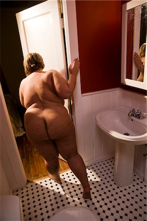 Overweight nude woman closing bathroom door, rear view Stock Photo - Rights-Managed, Code: 842-02650281