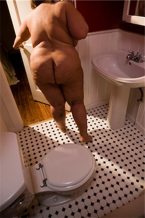 Overweight nude woman closing bathroom door, rear view Stock Photo - Rights-Managed, Code: 842-02650282