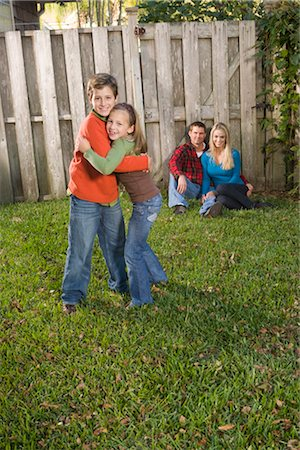Portrait of young happy family relaxing in the backyard, looking at camera Stock Photo - Rights-Managed, Code: 842-02650348