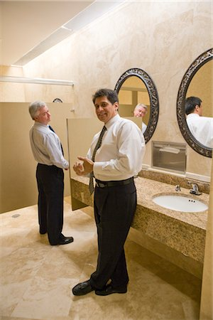 Two multi-ethnic businessmen standing in office bathroom, smiling Stock Photo - Rights-Managed, Code: 842-02650589