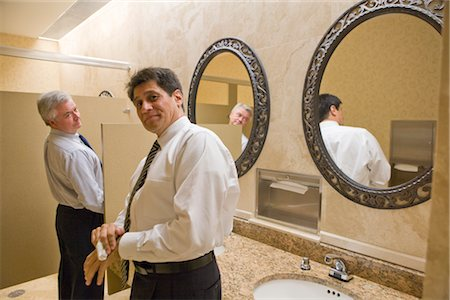 Two multi-ethnic businessmen standing in office bathroom, smiling Stock Photo - Rights-Managed, Code: 842-02650590
