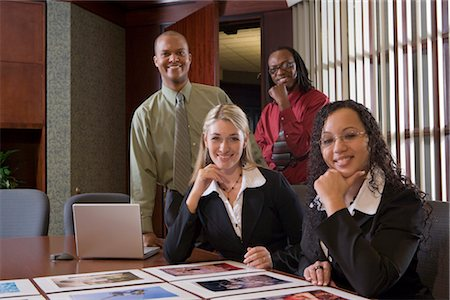 Four multi-ethnic businesspeople meeting in conference room, reviewing presentation Stock Photo - Rights-Managed, Code: 842-02650700