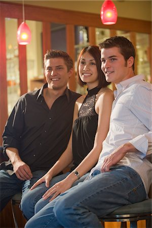 Portrait of young adult friends sitting together in front of bar Stock Photo - Rights-Managed, Code: 842-02651253