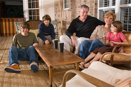 Portrait of family sitting together on porch Stock Photo - Rights-Managed, Code: 842-02651467