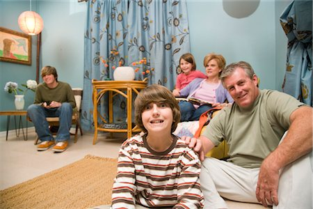 Portrait of family sitting together in living room Stock Photo - Rights-Managed, Code: 842-02651501